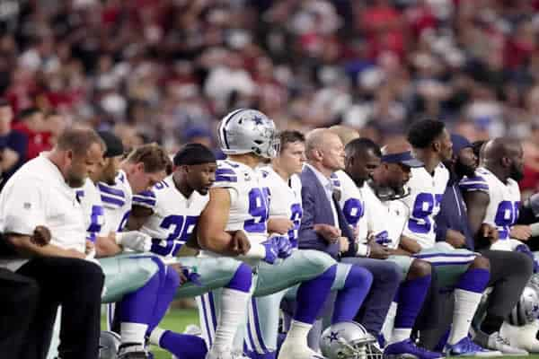 NFL football players kneeling during Anthem