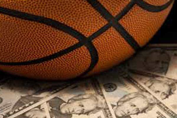 A basketball sitting on money