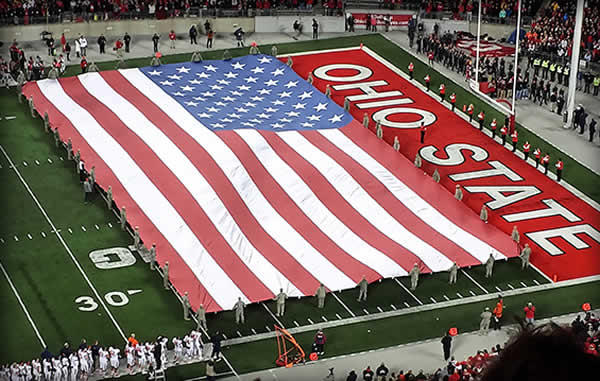 Ohio State and US flag on football field
