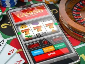 smartphone with online casino app among retail casino table game paraphernalia