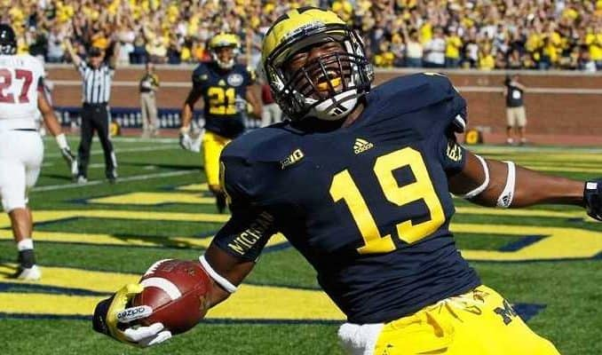 michigan wolverines football player devin funchess scores a touchdown
