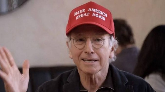 larry david of curb your enthusiasm wearing a red donald trump maga hat