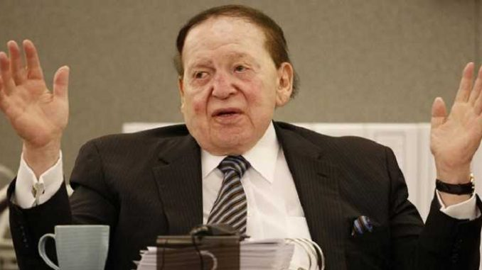 casino magnate sheldon adelson with his arms raised in exasperation