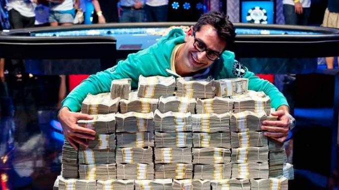 big poker win as player hugs pile of money